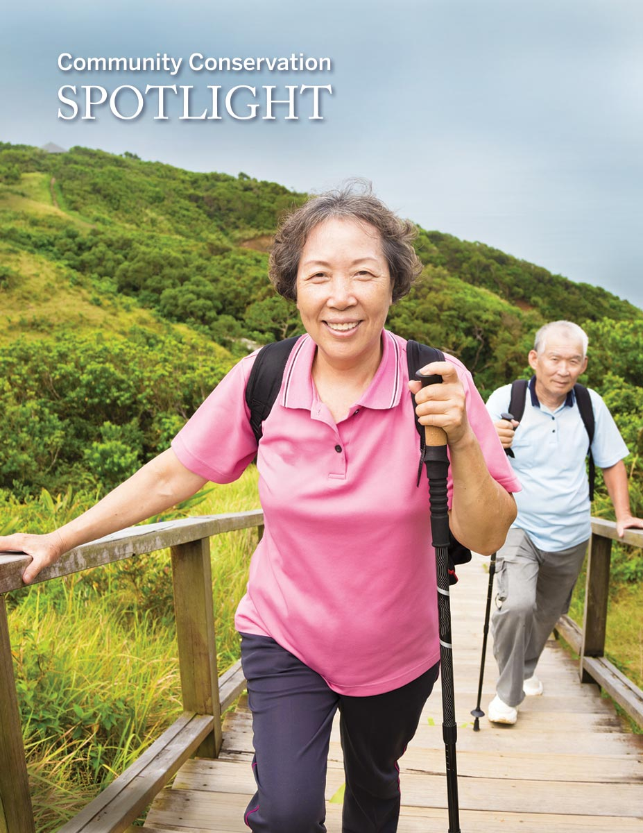 Cover photo of two elders climbing trail stairs