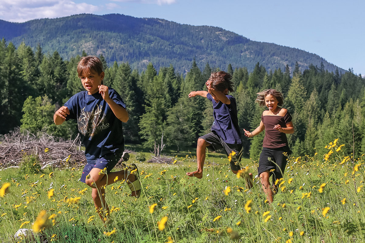 Kids running through the field
