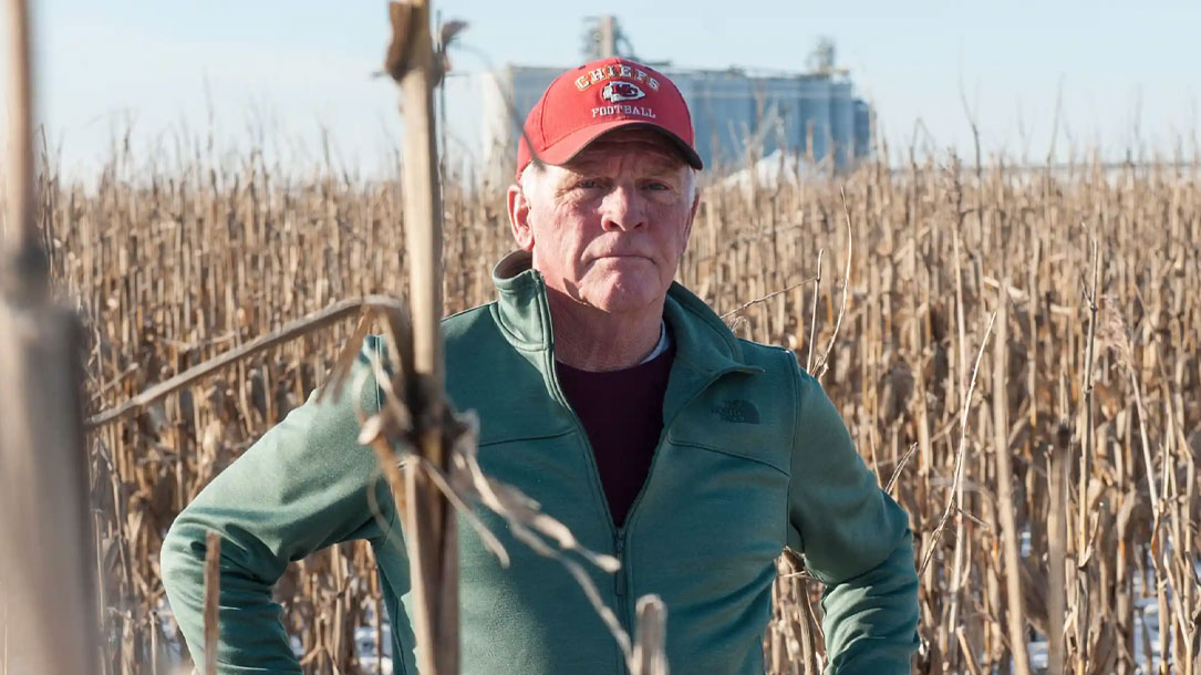 Midwest Farmer In Field With Red Hat