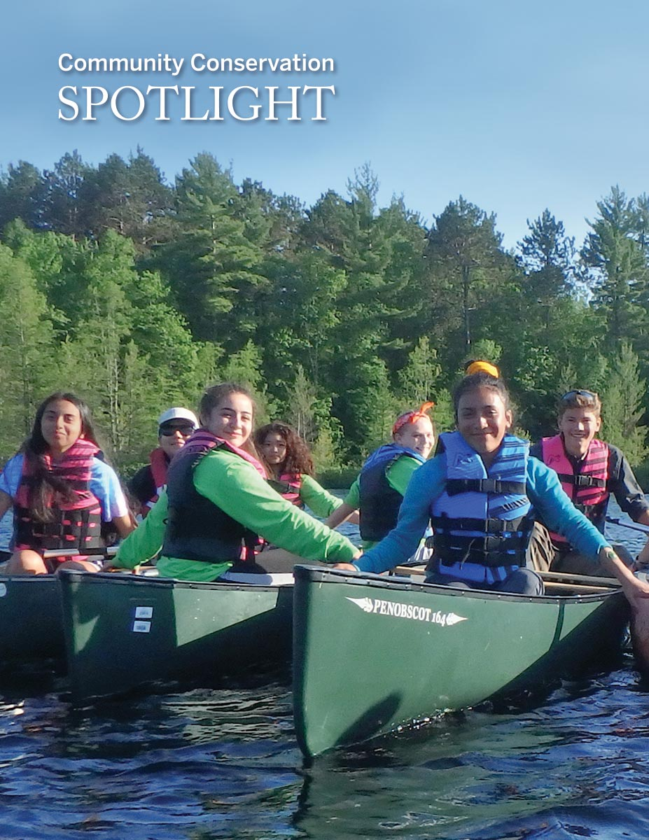 Canoes filled with youth discovering the outdoors