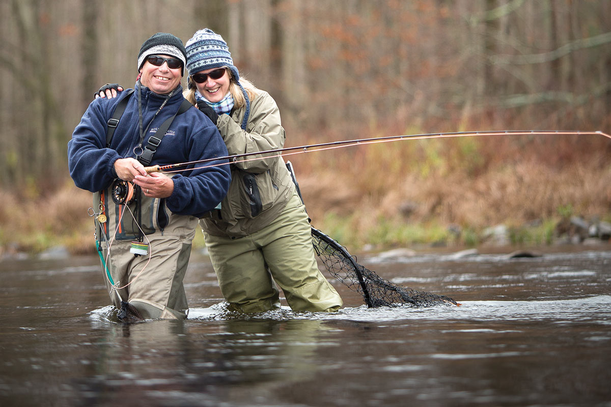 couple fly fishing in the fall