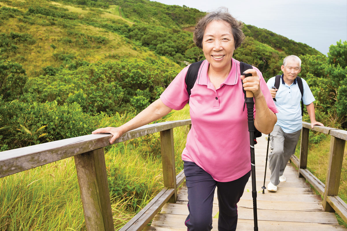 Asian Elders Climbing Trail Stairs
